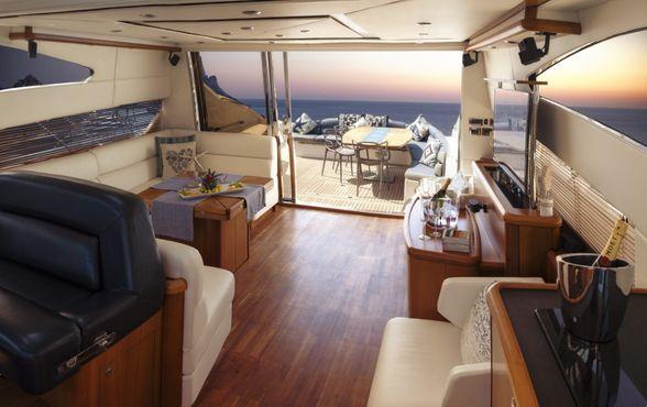 Predator-72-Yacht-Ibiza-Living-room-sunset